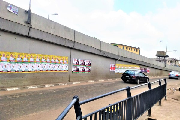 A jumble of 2019 political posters on the wall of a crossbridge in Lagos