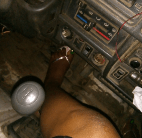A Nigerian female's foot on the pedal