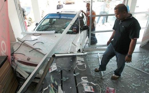 a-car-crash-into-a-shop-and-a-black-man