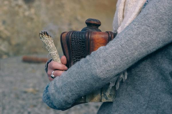 women holding an urn