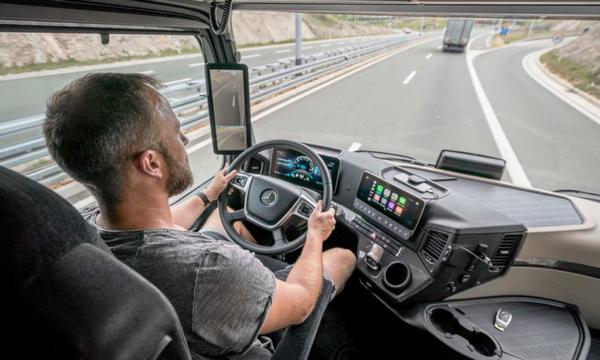 A man behind the wheel of a Mercedes-Benz Atros 2019