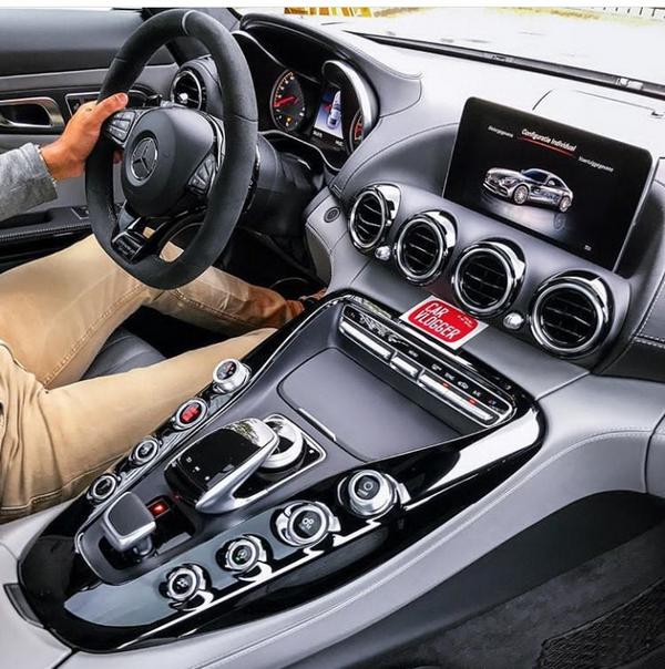A man driving a Mercedes-Benz