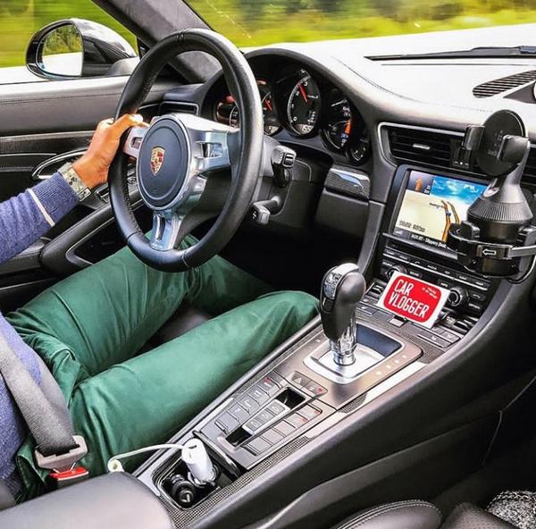 A man behind the wheel of a Porsche