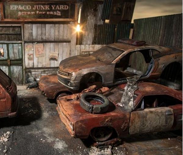 Broken Miniature cars in a garage