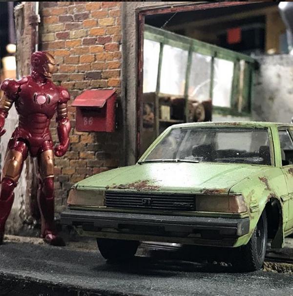 a Eddie Putera' miniature car and iron man