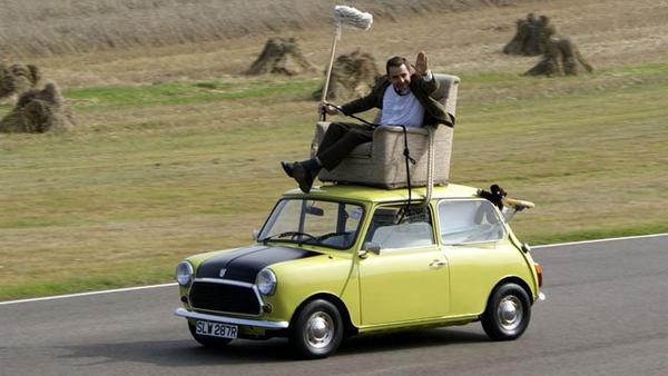 Mr. Bean on a yellow car
