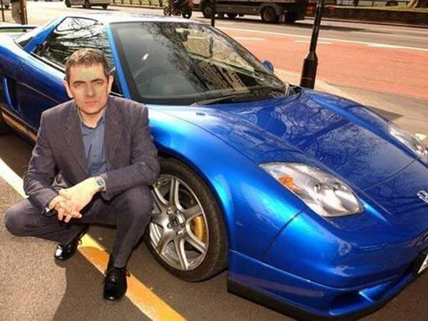 Mr. Ben beside a blue car