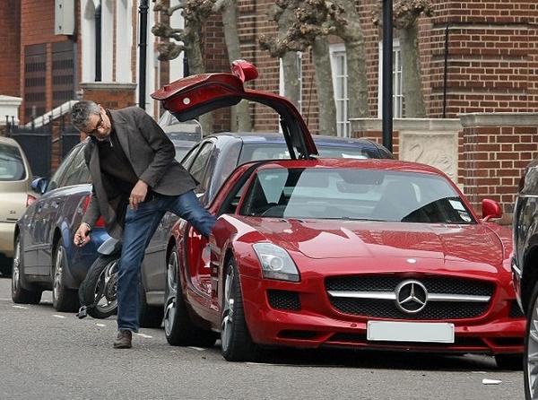 Mr. Bean gets into a Mercedes-Benz