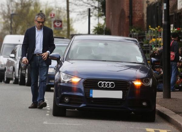 Mr. Bean beside an Audi