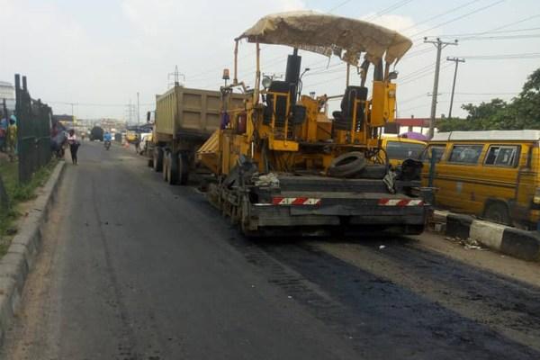Bulldozer surfacing the road
