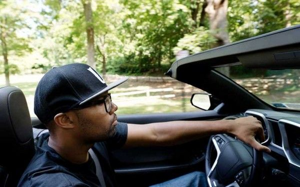 a black man driving a car