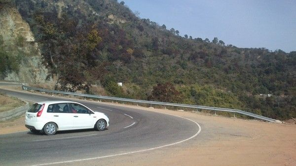 a white car taking the corner