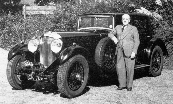 Walter Owen Bentley beside a Bentley car