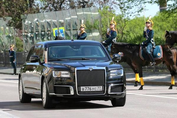 Putin's limousine running on the road