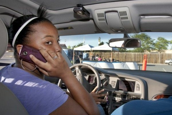 a woman using phone while driving