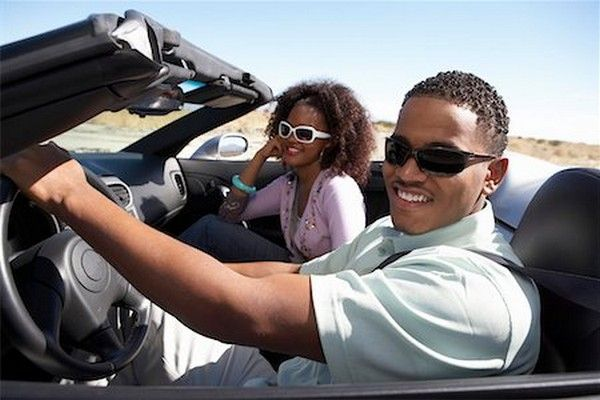 black man and woman driving car