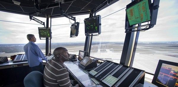 a black man in the air traffic control station