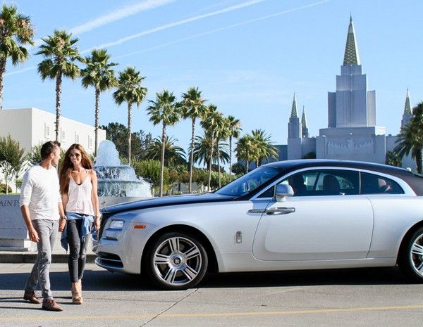 a Rolls Royce and 2 people