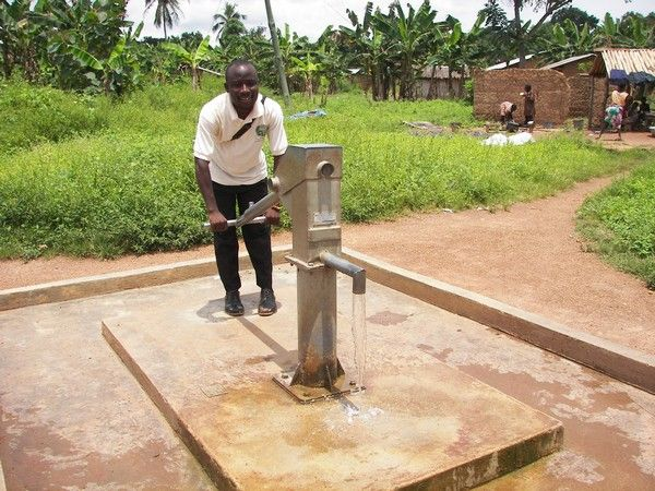 a man pumping water from borehole