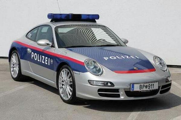 a silver Porsche 911 car of Austrian police