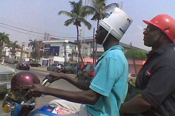 2 men wearing helmets
