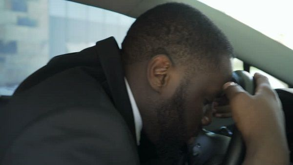 an exhausted Danfo bus driver
