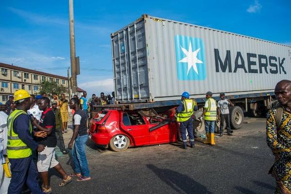 the Volkswagen Golf crashed under a truck