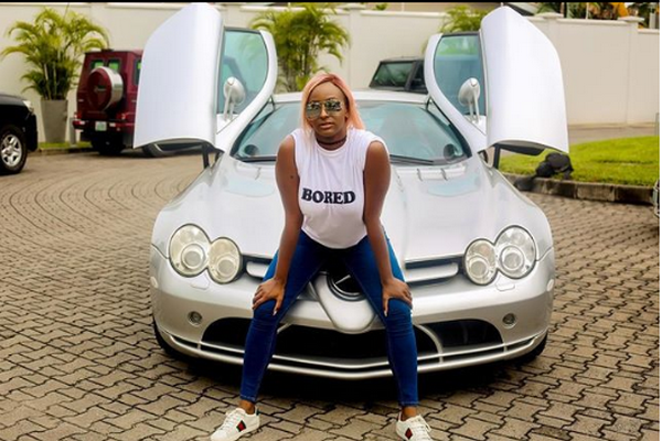 Cuppy poses with her Mercedes-Benz