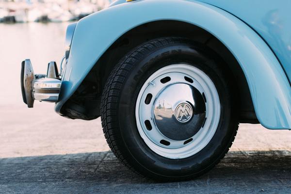 The steel wheel of a Volkswagen Beetle