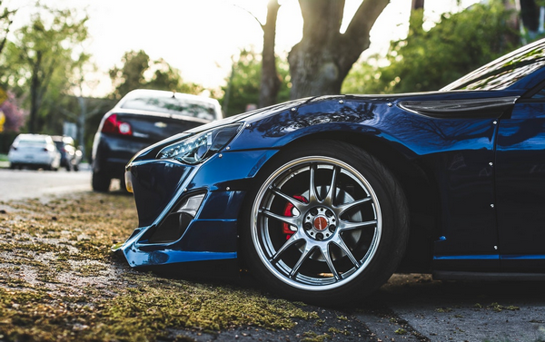 The front end of a blue car