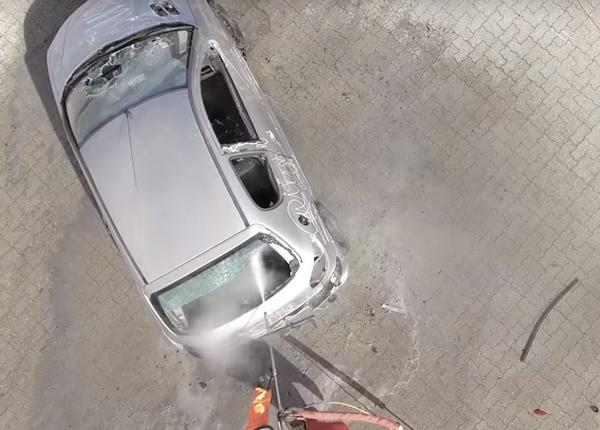 car washer breaking a car