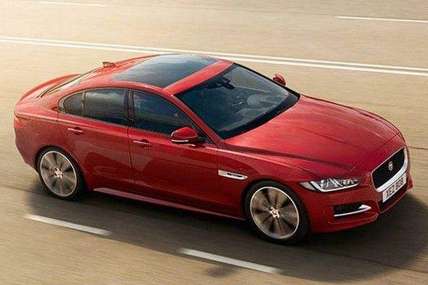 a red Jaguar XE diesel car
