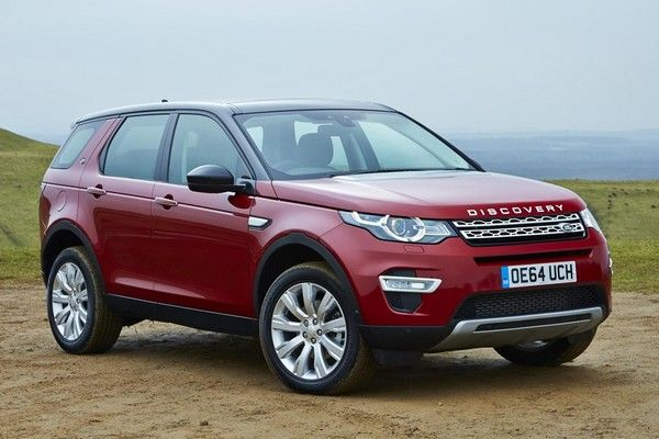a red Land Rover Discovery Sport diesel