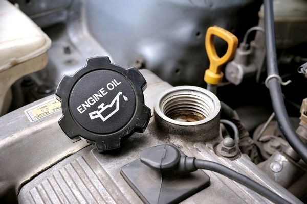 Image of an oil filler cap opened completely