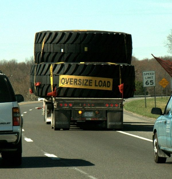 image-of-giant-off-the-road-tires-ontruck-being-transported