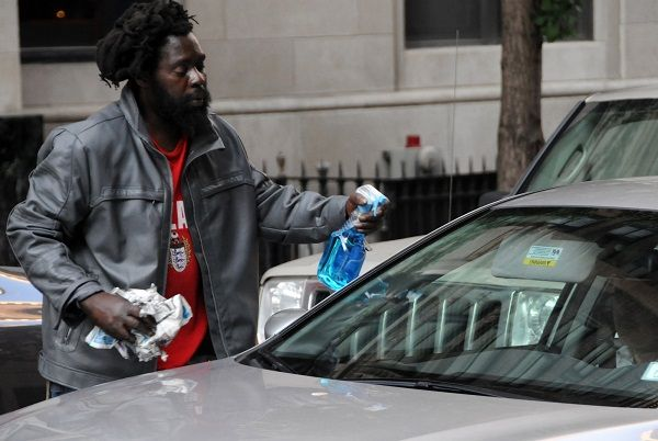 image-of-a-man-about-to-clean-a-windshield-with-a-rough-clothing