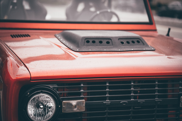 The hood of a red car