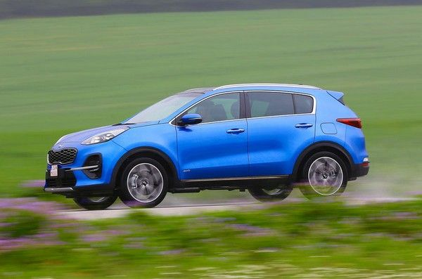 A-blue-Kia-Sportage-on-road