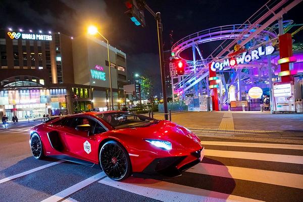 A red Lamborghini crossing the crossroad
