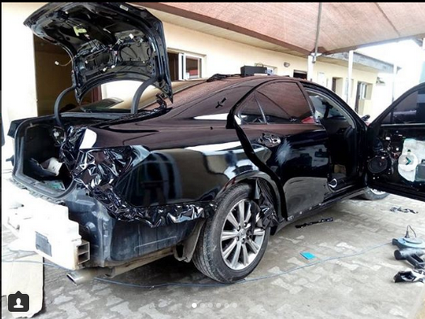A black car being repaired]
