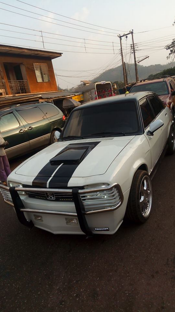angular front of a redesigned car made by a Nigerian man