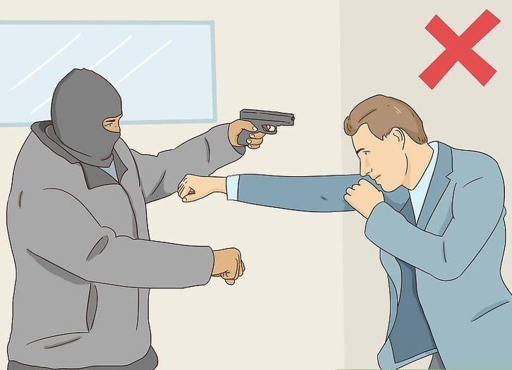 a man trying to punch a robber