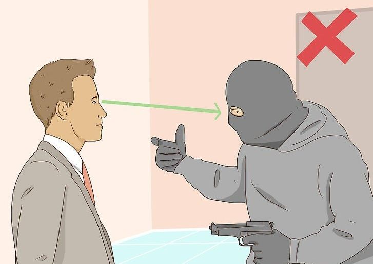 a man making eye contact with a robber