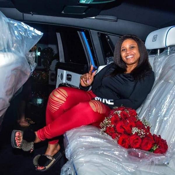 Juliet-Okonkwo-sitting-on-car