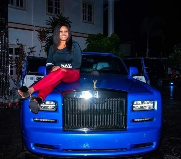 E-Money's-wife-sitting-on-a-blue-Rolls-Royce-Phantom