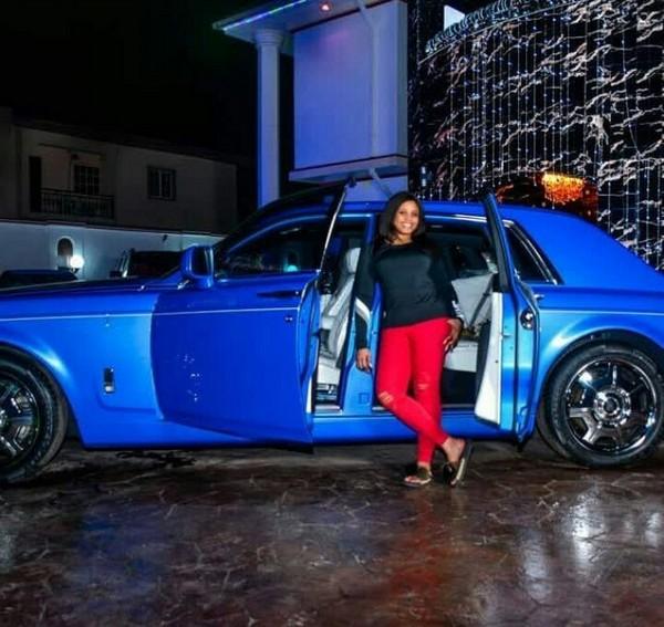 E-Money's-wife-standing-next-to-a-Rolls-Royce-Phantom