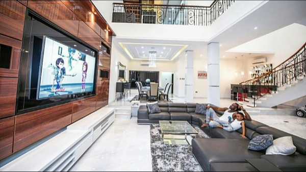 a large TV screen in P-Square's mansion on Banana island, Lagos
