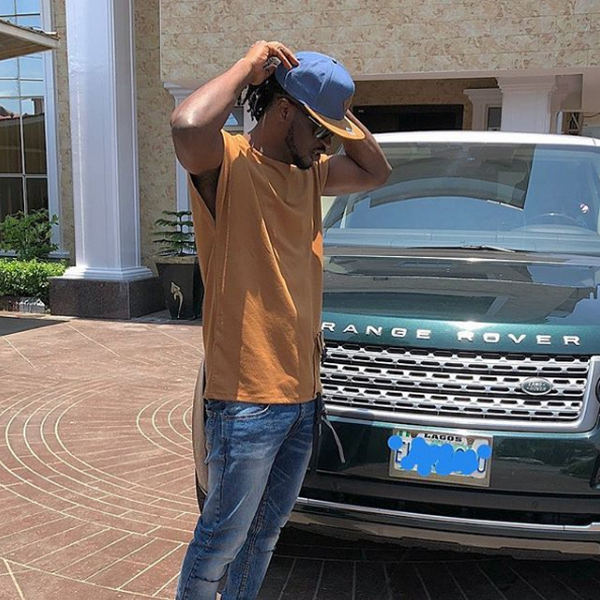 Paul Square posing in front of his Range Rover