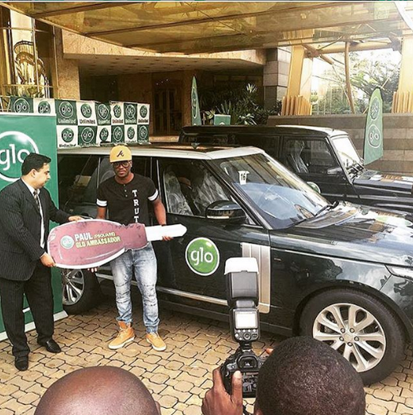 Paul Square receives the Range Rover key from GLO