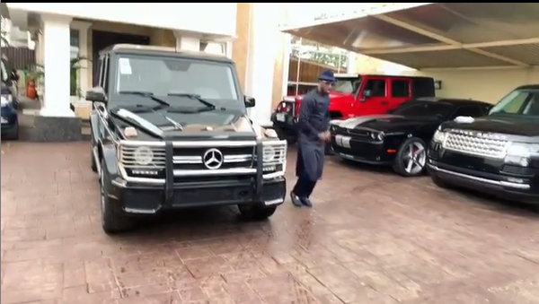 Peter Square dancing around his Mercedes